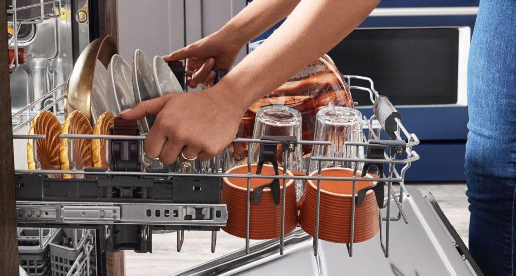 Woman At Dishwasher