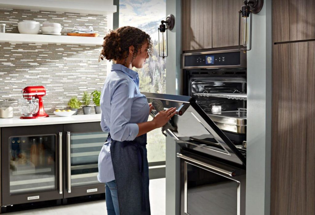 Woman At Oven